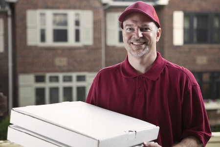 delivery service: Pizza delivery guy  Stock Photo