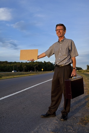 Businessman hitchhiking to work