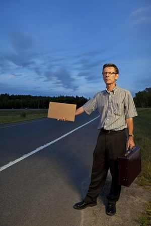 Businessman hitchhiking to work  photo