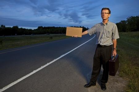 Businessman hitchhiking to work