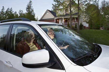 Two men setting GPS before carpooling from home  photo