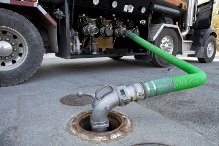 pumping: Fuel Delivery Tanker  Stock Photo