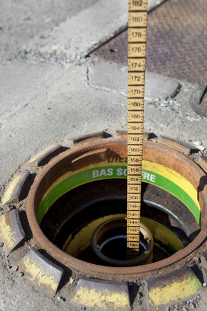 Measuring gasoline inventory with a dip stick  photo
