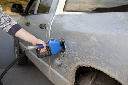 Man pumping gas into a pickup truck Stock Photo - 10555598
