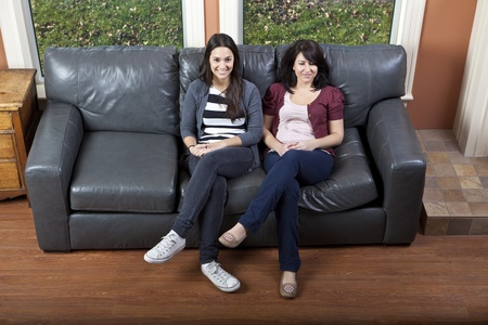family sofa: Friends watching TV happy