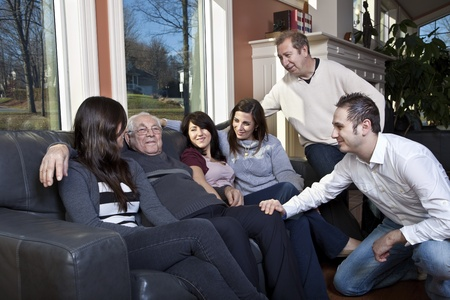 family support: Family visiting elderly relative at a retirement home  Stock Photo