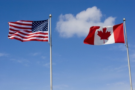 US and Canadian Flags  免版税图像