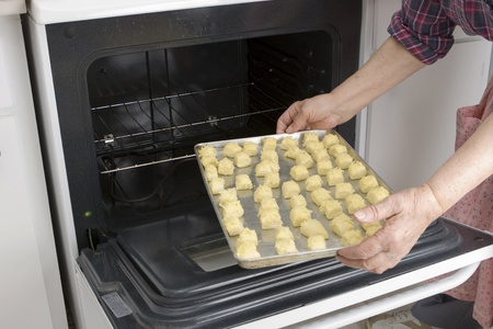 Grandma preparing baking and serving her cheesepuff recipe (series of images) Stock Photo - 10555308