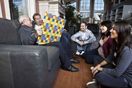 community service: Senior man story telling to his family  Stock Photo