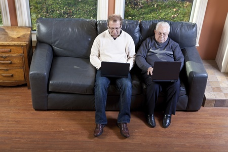 Senior man and his son using laptop computer Stock Photo - 10555741