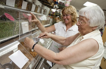 community outreach: Volunteer helping senior with her shopping