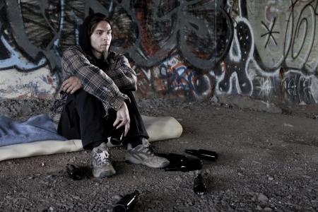 homeless man: Homeless alcoholic drinking beer