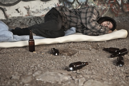 destitute: Homeless alcoholic sleeping outdoors  Stock Photo