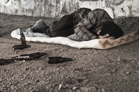 substance abuse: Homeless alcoholic sleeping outdoors  Stock Photo