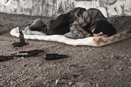 alcoholic man: Homeless alcoholic sleeping outdoors  Stock Photo