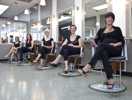 stylists: Team of hairdressers in a beauty salon