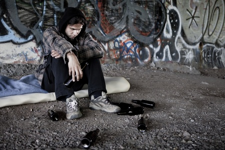 substance abuse: Homeless alcoholic drinking beer