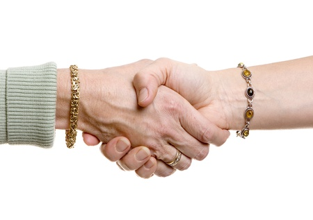 close up: Women in business handshake