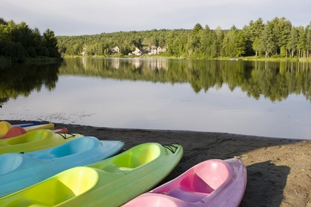 Kayaks and Canoes at a lake photo