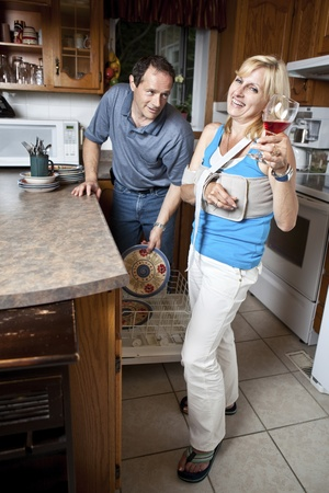 Woman enjoying Post Operative Recovery with her man servant by her side photo