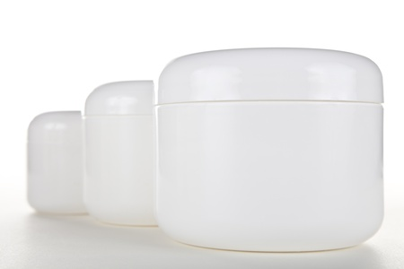 cosmetic cream: Multiple Cream Jars Stock Photo