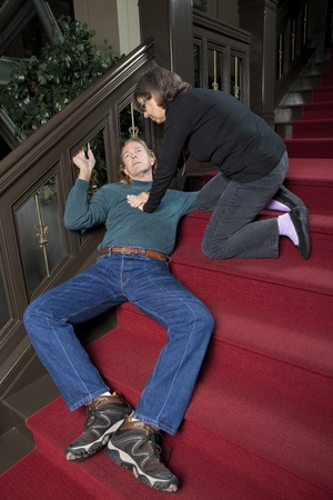 Woman giving CPR to passed out man