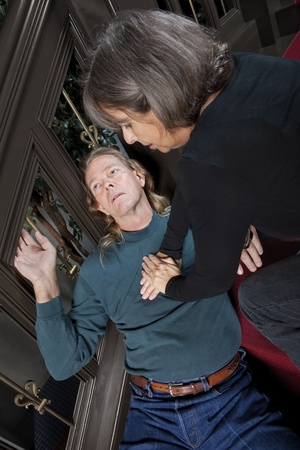 the unconscious: Woman giving CPR to passed out man