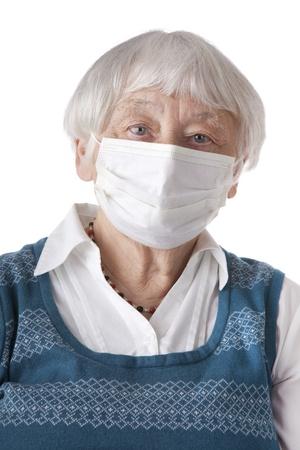 swine flue: Senior woman with flu mask