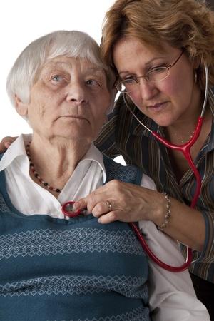 Female doctor examining senior patient photo