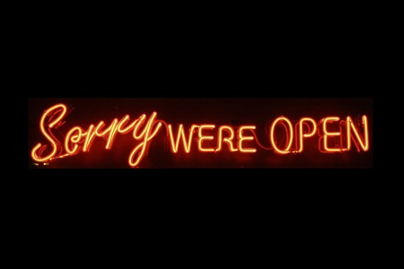 neon sign: Sorry were open neon signage