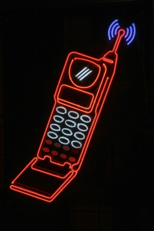 celphone: Retro cel phone neon signage Stock Photo