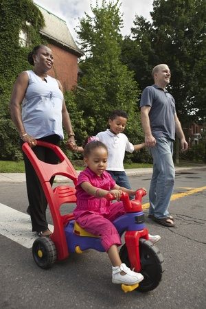 multi family house: Family going for a walk Stock Photo