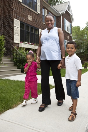 single family house: Happy pregnant mother with her kids Stock Photo