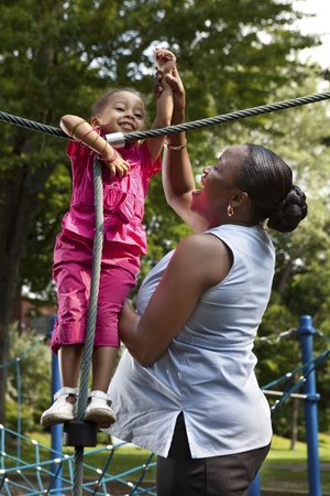 Mother and daughter playing at a park photo