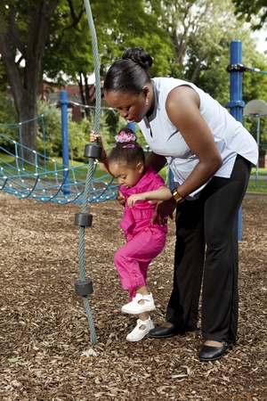 Mother and daughter playing at a park Stock Photo - 10611944
