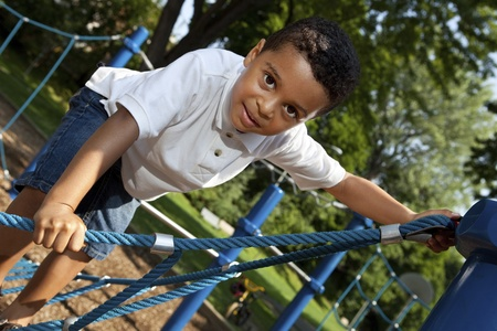 children playground: Young boy playing at a park