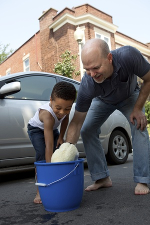 Father and son washing a car photo