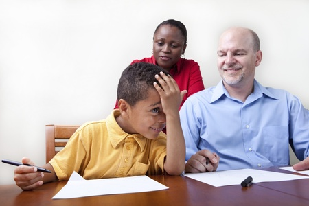 learning by doing: Parents helping son with homework