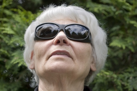 active adult community: Senior woman dark glasses