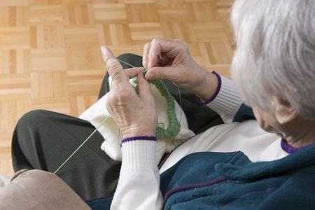 Senior woman knitting horizontal Stock Photo - 11133554