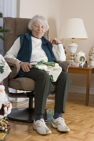 Senior woman knitting vertical  Stock Photo - 11133563