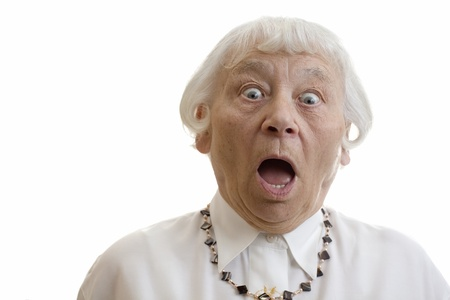 grimace: Senior woman studio portrait gasping shocked  Stock Photo