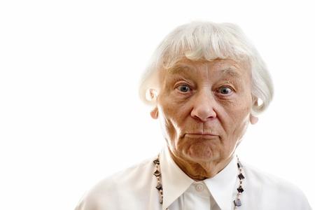 expression facial: Senior woman studio portrait surprised
