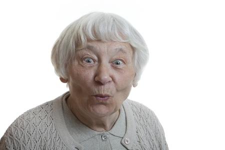 impressed: Senior woman studio portrait Happy surprised puckering