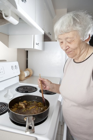 Senior woman cooking  photo