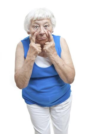 Disbelief senior woman portrait  photo