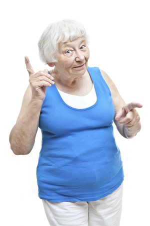 woman pointing: Reminding senior woman portrait