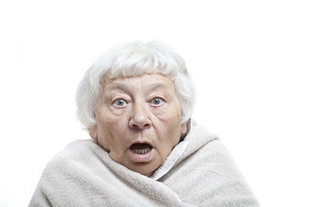 woman in bath: Shocked senior woman with a towel