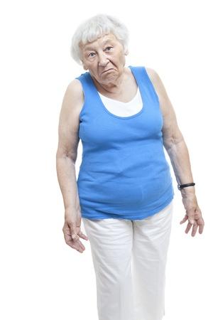 ambivalent: Unimpressed senior woman studio portrait