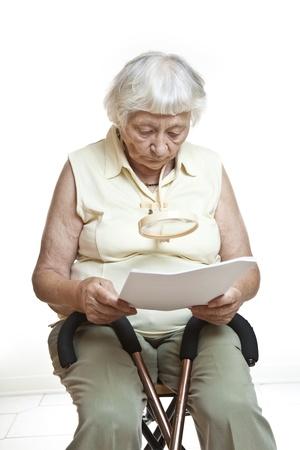 Concerned senior reading letter  photo
